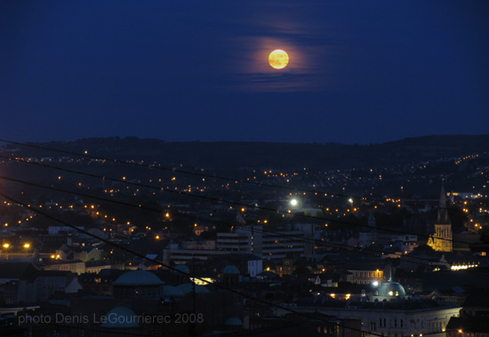 rising moon over cork city